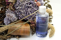 Dried flowers and scented oil Stock Image