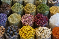 Dried flowers and spices at the Herbs Market in the Dubai Spice Souk. Colorful, fragrant dried flowers and spices are for sale at Herbs Market in the Dubai Spice Royalty Free Stock Photography