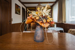Dried flowers vase. A vase with some decorative dried flowers on a coffee table stock image