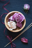 Dried flowers in wooden bowl and aroma sticks Royalty Free Stock Image