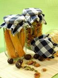 Dried food, corn and seeds in glass jar Stock Images