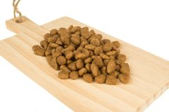 Dried food for dogs or cats on wooden cutting board. Pet care.  stock photography
