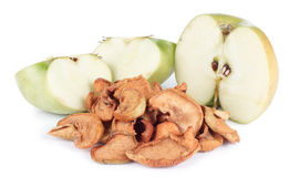 Dried and fresh apple. Dried bits of apple with fresh apples on white Stock Image