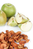 Dried and fresh apple. Dried bits of apple with fresh apples on white Stock Images