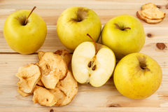 Dried and fresh apples on a wooden background Royalty Free Stock Photo