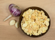 Dried and fresh garlic on the table Stock Photos