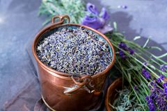 Dried and fresh lavender flowers, ingredients for aroma spa treathment and bodycare for women. In old copper bucket stock photos