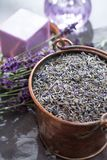Dried and fresh lavender flowers, ingredients for aroma spa treathment and bodycare for women. In old copper bucket stock photography