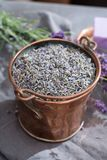 Dried and fresh lavender flowers, ingredients for aroma spa treathment and bodycare for women. In old copper bucket stock photo