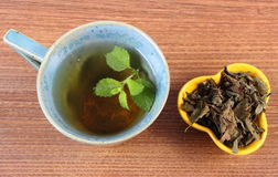Dried and fresh lemon balm, cup of herbal beverage Stock Photography