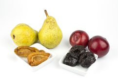 Dried and fress plums and pears Royalty Free Stock Photos