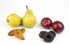 Dried and fress plums and pears Stock Images
