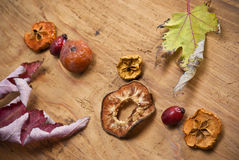 Dried fruit. Selected dried fruits arranged on the wooden kitchen table Royalty Free Stock Image