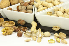 Dried fruit. Peanut pistachios nuts and walnuts Royalty Free Stock Photos
