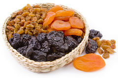 Dried fruit are in a  basket. Dried fruit are in a small basket Stock Images
