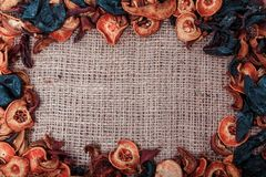 Dried fruit and berries on sacking background Royalty Free Stock Photo