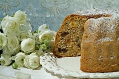 Dried Fruit Cake. And white buttercups in front of a window Stock Image