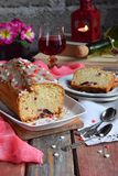 Dried fruit cake with raisins, apricots, cherry and glass of red wine, bottle and flower rustic wooden background. Valentines day. Still life. Sliced freshly royalty free stock photography