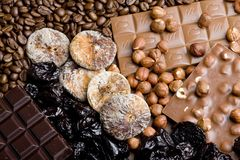 Dried fruit with chocolate and coffee beans. Inside, indoor, indoors, interior, interiors, food, nutritive, nourishment, nutrition, fruits, dry, fig, figs stock images