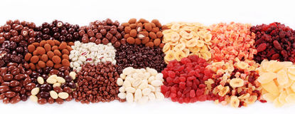 Dried fruit and chocolate covered nuts Stock Photo