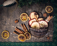 Dried fruit with cinnamon sticks and anis star in basket. On dark wooden background Stock Images