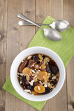 Dried fruit compote with almond sliver. And spoon royalty free stock photo