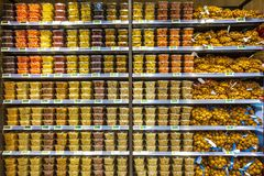 Dried fruit containers on shelves inside a supermarket. Multicolors. ROME, ITALY. December 05, 2018: Numerous containers of dried fruit placed on shelves inside royalty free stock photo