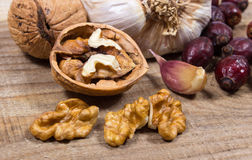 Dried fruit of hawthorn, garlic and walnuts. The concept of alternative medicine. Stock Image