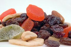 Dried fruit mix. An assortment of dried fruit on white stock image