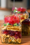 Dried fruit mix and honey. Royalty Free Stock Photos