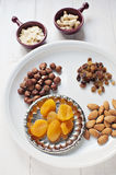 Dried fruit and nuts. Dried apricots and raisins with raw almonds, hazelnuts, cashew and almond flakes Royalty Free Stock Photo