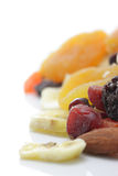 Dried fruit and nuts. Dried snack fruit - bananas, cherries, plums, pineapple, apricots and almonds Stock Photo