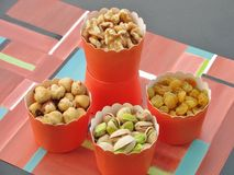 Fall party snacks for a healthy lifestyle: walnuts, hazelnuts, pistachios, golden raisins Stock Images