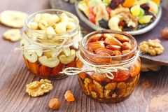 Dried fruit and nuts in honey Royalty Free Stock Photos