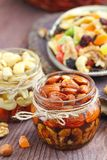 Dried fruit and nuts in honey Stock Image
