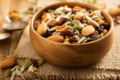Dried fruit and nuts trail mix. With almonds, raisins, seeds and apples in a wooden bowl Royalty Free Stock Image