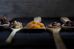 Dried Fruit and Nuts on Wooden Spoons - Selective focus Royalty Free Stock Photos