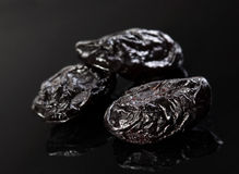 Dried fruit prune. Closeup on black background Stock Images