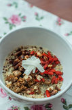 Dried Fruit Quinoa. Milky quinoa with goji, coconut, figs and nuts Royalty Free Stock Image