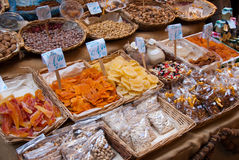 Dried fruit and seeds at the fruit market. Several baskets filled with different kind of dried fruit and seeds at the fruit market in Palermo in Sicily, Italy Royalty Free Stock Image