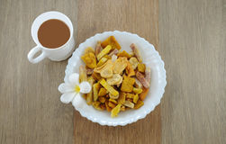 Dried fruit snack with coffe break in the mornig. My friend made dried fruit at home and mixed coffee to serve customer Royalty Free Stock Photography