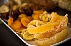 Dried fruit still life. Still life composition of various dried fruit on party plate Royalty Free Stock Photos