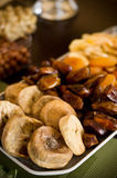 Dried fruit still life. Still life composition of various dried fruit on party plate Royalty Free Stock Image