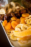 Dried fruit still life. Still life composition of various dried fruit on party plate Royalty Free Stock Photography