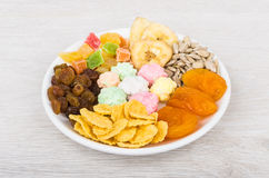 Dried fruit, sunflower seeds, corn flakes and nuts in sugar Royalty Free Stock Photography