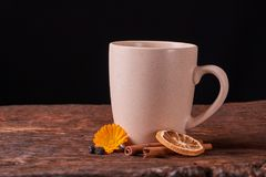 Dried fruit tea for healthy breakfast. cup of cream color and flower on wooden table. Concept of health food. Dried fruit tea for healthy breakfast. cup of cream royalty free stock image