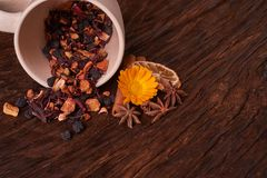 Dried fruit tea for healthy breakfast. cup of cream color and flower on wooden table. Concept of health food. Dried fruit tea for healthy breakfast. cup of cream royalty free stock photos