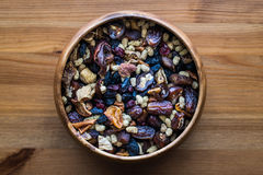Dried Fruit Walnut, fig, palm, mulberry, date in a wooden bowl Royalty Free Stock Images