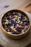 Dried Fruit Walnut, fig, palm, mulberry, date in a wooden bowl Royalty Free Stock Photo