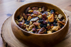 Dried Fruit Walnut, fig, palm, mulberry, date in a wooden bowl Stock Image